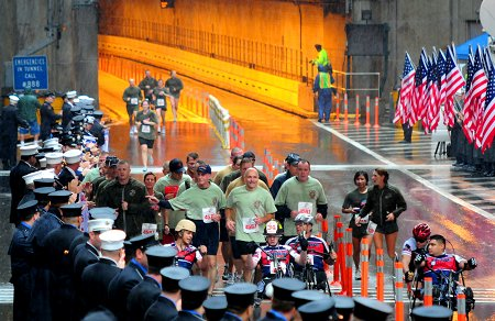 Chief of Department Salvatore Cassano (runner number 4587) finishes the Tunnel to Towers race with Wounded Warriors.