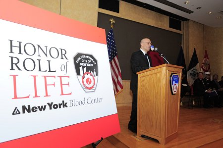 Fire Commissioner Salvatore Cassano welcomes the crowd to the sixth annual Honor Roll of Life ceremony.