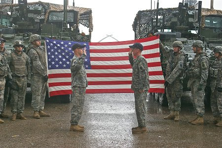 Members of the U.S. Army were sworn in beside the American flag the firefighters sent.