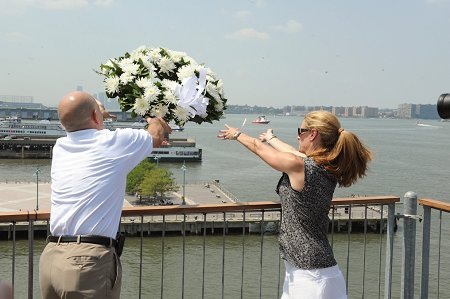 Fire Commissioner Salvatore Cassano and Executive Director of the Intrepid Sea, Air and Space Museum Susan Marenoff throw a wreath into the Hudson River in honor of the Blessing of the Fleet.