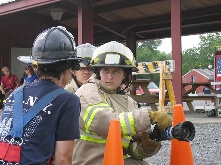 FDNY Lt. Michele Fitzsimmons teaches campers about water supression.