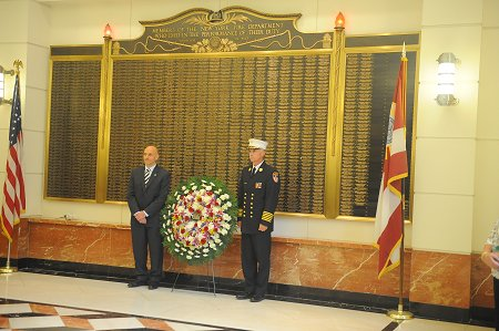 Fire Commissioner Salvatore Cassano (left) and Chief of Department Edward Kilduff lay a wreath at the FDNY Headquarters memorial wall on Sept. 10. The wall lists the names of all FDNY members who have died in the line of duty since the Department was established in 1865.