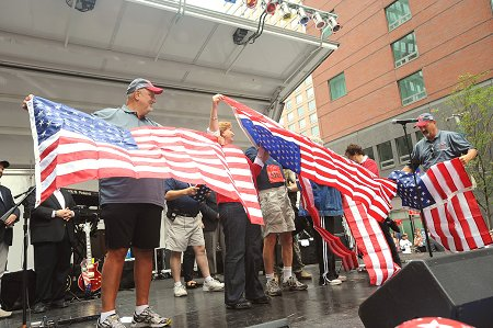 The Siller family at the 9th Annual Tunnel to Towers Run, holding a flag that flew in Afghanistan.