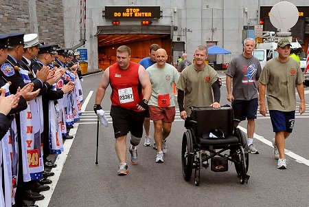 Fire Commissioner Salvatore Cassano runs with Wounded Warriors.