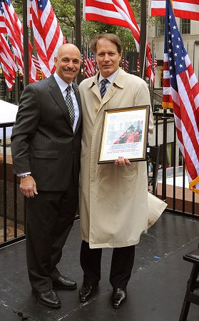 Fire Commissioner Salvatore Cassano gives Tom Madden, Senior Managing Director of Tishman Speyer, a Certificate of Appreciation for his organization's help with Fire Prevention Week.