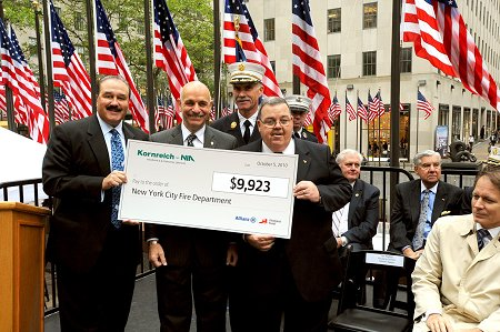 Kornreich Insurance and Fireman's Fund Insurance give the FDNY Foundation a $9,923 check for its fire safety efforts. (L to R) Steve Parnes of Kornreich Insurance; Fire Commissioner Salvatore Cassano; Terry McCormick of Fireman's Fund Insurance; and Chief of Department Edward Kilduff.