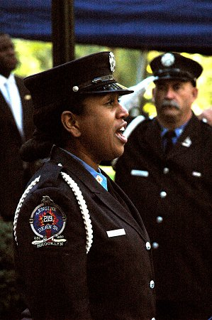 Firefighter Regina Wilson sings the National Anthem at the Memorial Day ceremony.