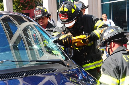 Firefighters demonstrate how they would extract a victim trapped in a vehicle during Fire Safety Day in Metrotech Commons.