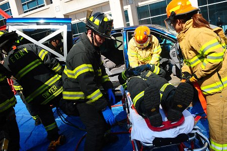 Firefighters and EMS members demonstrate how they extract and treat a victim trapped in a vehicle.