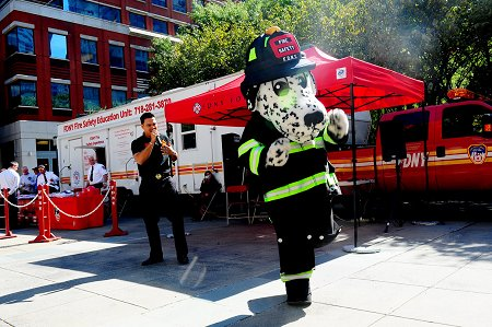 Hot Dog, the FDNY's fire safety mascot, dances to �ngel Alberto Crespo Ortiz's music. The singing/rapping firefighter from Puerto Rico sings fire safety songs for children.