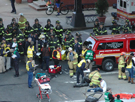 FDNY firefighters and EMS members arrive on the scene of the simulated car explosion.