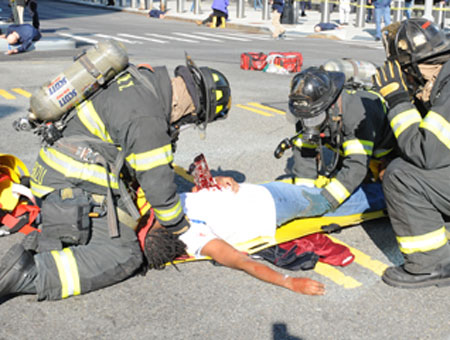 Firefighters treat a 'victim' during the drill.
