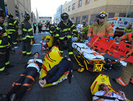 Firefighters and EMS members treat volunteers playing victims during the drill.