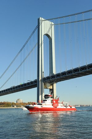 The Firefighter II passes under the Verrazano-Narrows Bridge when it arrives in New York on Nov. 13.