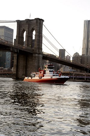 The new fireboat passes under the Brooklyn Bridge.