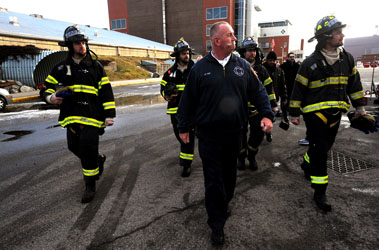 Mets Pitchers Robert Parnell, Dillon Gee, R.A. Dickey and Mike Pelfrey reporting for training with FDNY Lt. Thomas Foy.