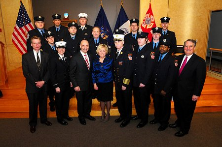 Caption: FDNY bone marrow and stem cell donors join FDNY and NYBC officials in front of the Honor Roll of Life plaque, including Lt. Michele Fitzsimmons (second from left, front row), Director of the FDNY's Health Service Bureau Mary T. McLaughlin (fourth from left, front row), and Firefighter Owen Fay (third from right, front row).