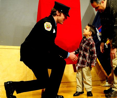 Firefighter Owen Fay, Engine 33, meets his recipient, 5-year-old Luca Campana.
