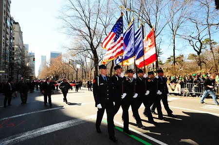 The FDNY Color Guard marches up Fifth Avenue.