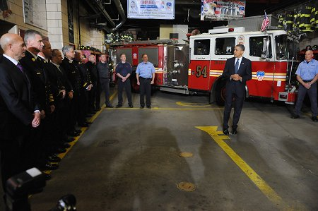 President Obama addresses all members present on the firehouse apparatus floor.