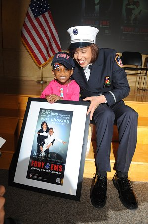 EMS Lt. Kim Weaver and Shamia Jones, who she saved when the girl was just a year old.