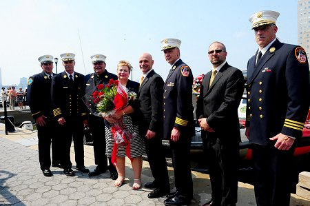 (L to R) Chief of Marine Division James Dalton, Chief of Department Edward Kilduff, FDNY Chaplain Monsignor John Delendick, Director of FDNY Special Events Lenore Koehler, Fire Commissioner Salvatore Cassano, Chief of Operations Robert Sweeney, CEO of SAFE Boats International Scott Peterson and Chief of Special Operations Command William Seelig.