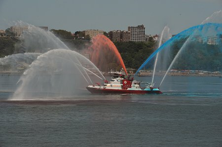 The Firefighter II fireboat gives a water display for the Blessing of the Fleet ceremony.