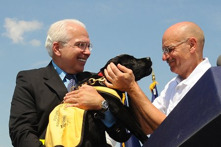 Fire Commissioner Salvatore Cassano and CEO of the Guide Dog Foundation for the Blind Wells Jones with the puppy named to honor FDNY members. Commissioner Cassano named her �Bravest� during the ceremony.