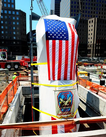 Ladder 3's apparatus is lowered into the 9/11 Memorial Museum by a crane.