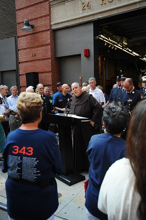 The Walk begins outside Engine 1/Ladder 24, where FDNY Chaplain Father Christopher Keenan gave a tribute.