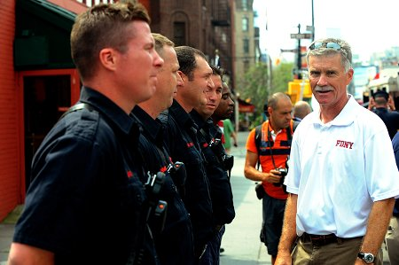 Chief of Department Edward Kilduff speaks with the members of Squad 18. The firehouse was one of the stops along the walk.