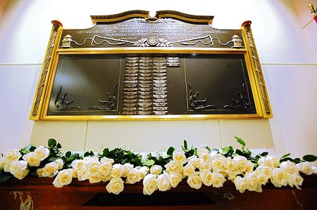 The Memorial Wall honoring the 55 members who have died as a result of World Trade Center-related illnesses. It hangs in the lobby of FDNY Headquarters.