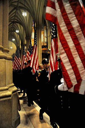 FDNY members carried 343 American flags into the service, representing the 343 members killed on Sept. 11, 2001.