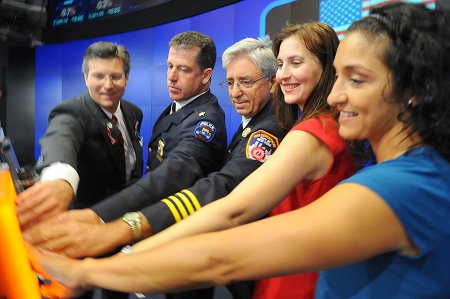 Manhattan Borough Commander James Esposito (center) and members of Engine 65 (not pictured) rang the opening bell of the NASDAQ on Sept. 9, in honor of the 10th anniversary of the Sept. 11 attacks, with members of various 9/11-related organizations.