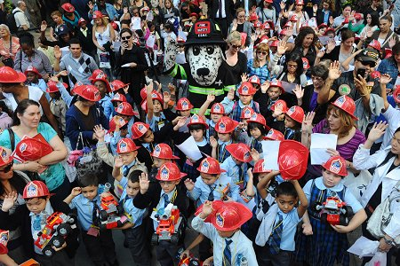 Children from schools in all five boroughs take the oath as Junior Firefighters and EMTs during the Fire Prevention Week kick off at Rockefeller Center.