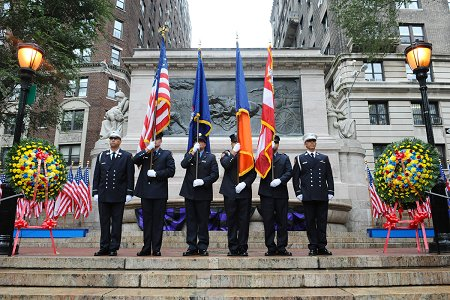 The Honor Guard in front of the Fireman's Monument on Riverside Drive.