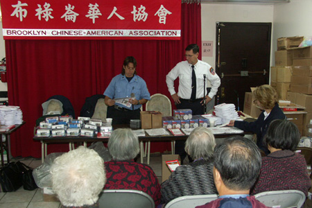 Seniors at the Chinese American Association learn about fire safety tailored to their needs.