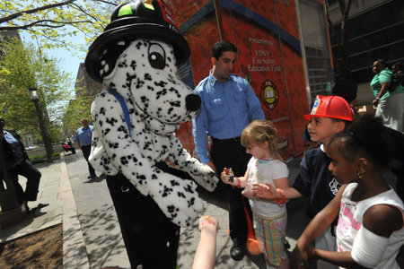 HotDog greets children during community event.