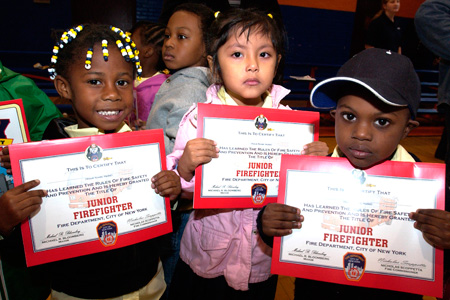 Schoolchildren receive Junior Firefighter certification after Training.