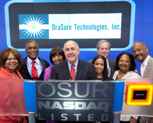 LaRay Brown, HHC Senior VP, 2nd from right, joined Douglas A. Michels, OraSure Pres. & CEO, center, at NASDAQ. (Photo: © 2012, The NASDAQ OMX Group, Inc.)